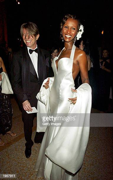 David Bowie and his wife Iman attend the Costume Institute Benefit Gala sponsored by Gucci April 28 2003 at The Metropolitan Museum of Art in New...
