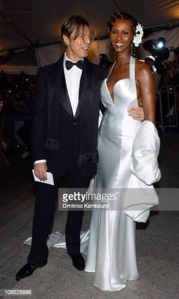 David Bowie and Iman during Costume Institute Benefit Dance 'Party of the Year' Arrivals at Metropolitan Museum of Art in New York City New York...
