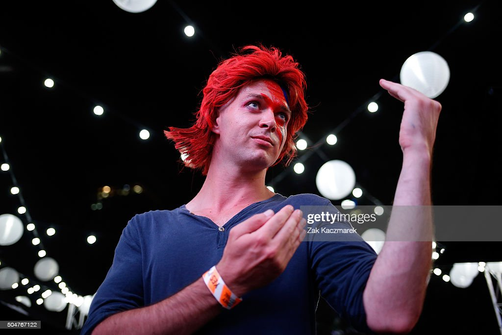 A <a gi-track='captionPersonalityLinkClicked' href=/galleries/search?phrase=David+Bowie&family=editorial&specificpeople=171314 ng-click='$event.stopPropagation()'>David Bowie</a> fan dressed as Ziggy Stardust poses as he pays tribute to <a gi-track='captionPersonalityLinkClicked' href=/galleries/search?phrase=David+Bowie&family=editorial&specificpeople=171314 ng-click='$event.stopPropagation()'>David Bowie</a> on January 13, 2016 in Sydney, Australia. <a gi-track='captionPersonalityLinkClicked' href=/galleries/search?phrase=David+Bowie&family=editorial&specificpeople=171314 ng-click='$event.stopPropagation()'>David Bowie</a> died on Monday, January 11 aged 69 following an 18-month battle with cancer.