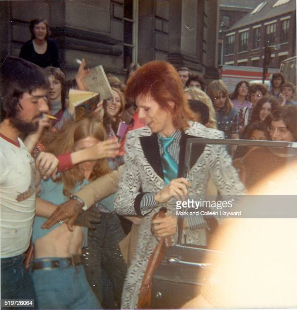 David Bowie gets out of a car surrounded by fans during his Ziggy Stardust era Unite Kingdom 1973