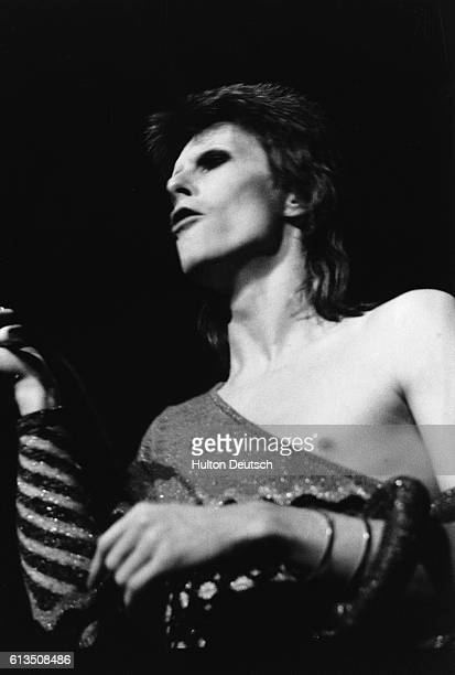 David Bowie in concert at the Hammersmith Odeon in the persona of his alter ego Ziggy Stardust