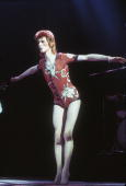 David Bowie performing as Ziggy Stardust in his 'woodland creatures' costume designed by Kansai Yamamoto at the Hammersmith Odeon 1973