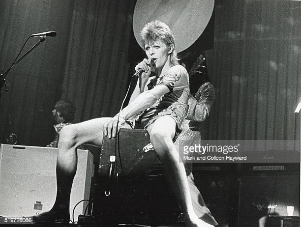 David Bowie performs on stage in Scotland on the Ziggy Stardust tour May 1973 Mike Gardon and Trevor Bolder are pictured behind