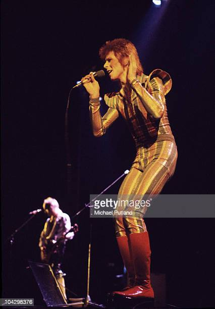 David Bowie performs on stage on his Ziggy Stardust/Aladdin Sane tour with Mick Ronson in the background in London 1973