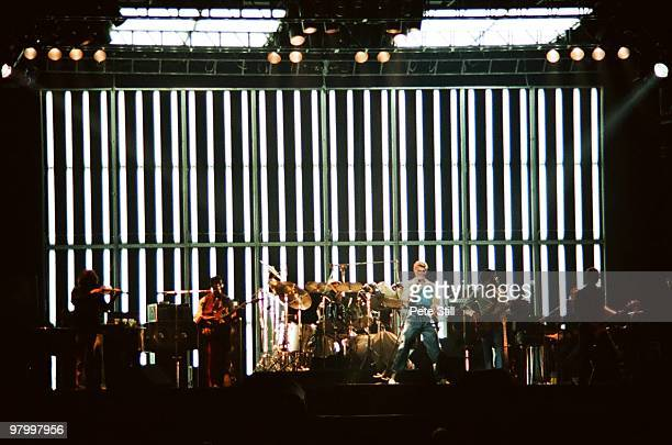 David Bowie performs on stage with LR Simon House Carlos Alomar Dennis Davis David Bowie George Murray and Adrian Belew at Earls Court Arena on...
