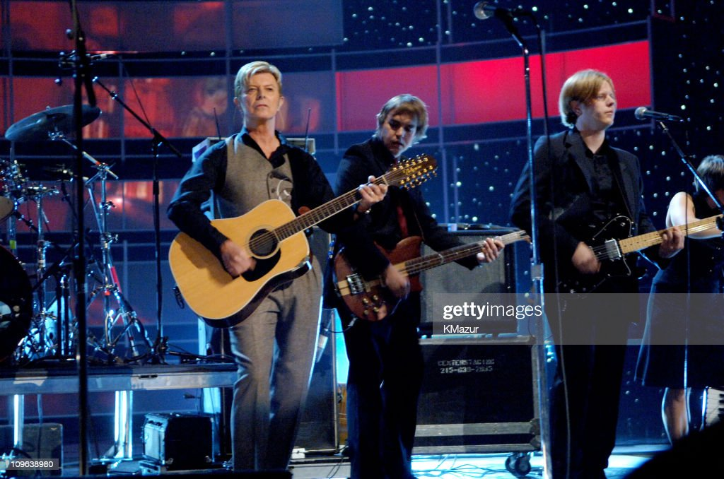 <a gi-track='captionPersonalityLinkClicked' href=/galleries/search?phrase=David+Bowie&family=editorial&specificpeople=171314 ng-click='$event.stopPropagation()'>David Bowie</a> performs with <a gi-track='captionPersonalityLinkClicked' href=/galleries/search?phrase=Arcade+Fire&family=editorial&specificpeople=2220929 ng-click='$event.stopPropagation()'>Arcade Fire</a> at Conde Nast's 2005 Fashion Rocks Show