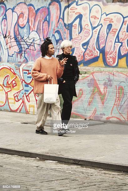 David Bowie portraying Andy Warhol performs a scene with Jeffrey Wright portraying JeanMichel Basquiat in the 1996 motion picture Basquiat directed...