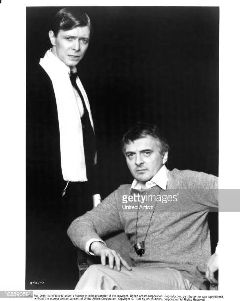 David Bowie stands beside David Hemmings on set of the film 'Just A Gigolo' 1978