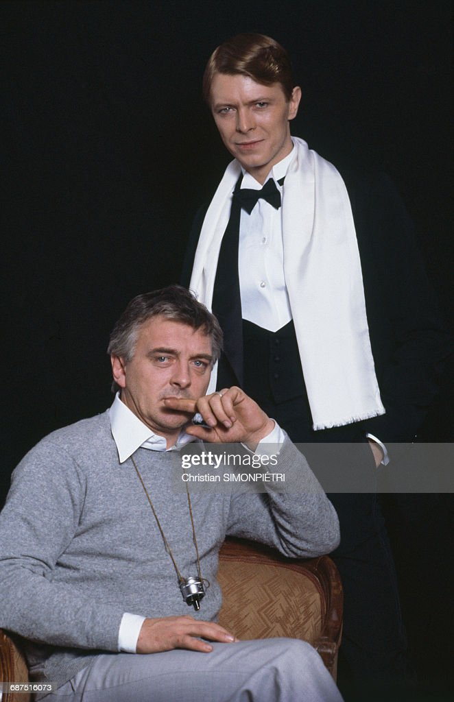 David Bowie (top) stands beside David Hemmings on set of the film 'Just A Gigolo', 21st December 1977.
