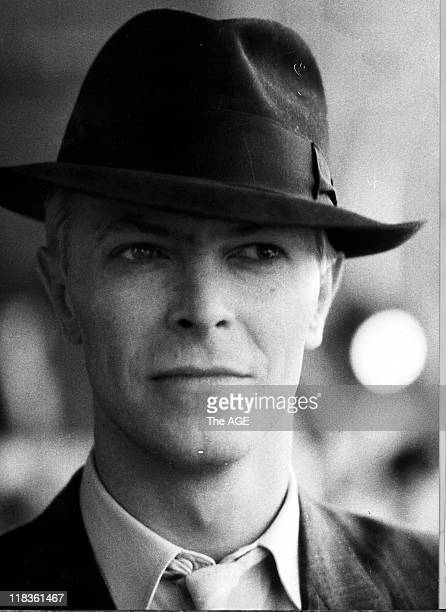 David Bowie wearing a hat as he arrives at Tullamarine Airport for concert at VFL Park in Melbourne exact date unknown circa 15 November 1983