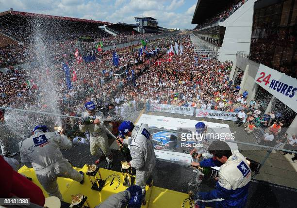 David Brabham of Australia Alexander Wurz of Austria and Marc Gene of Spain celebrating after driving the Peugeot Sport Total Peugeot 908 to victory...