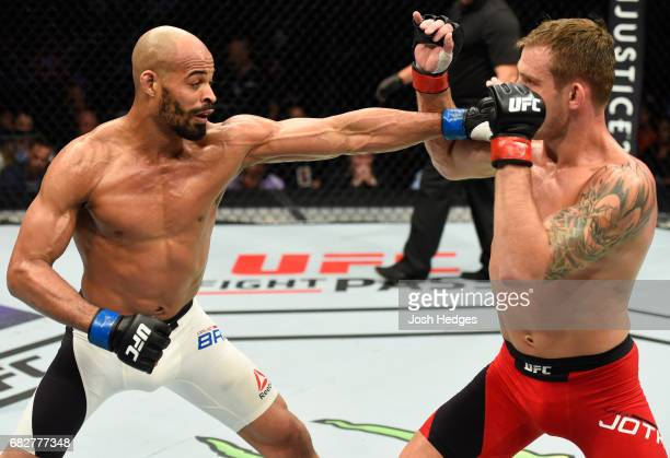 David Branch punches Krzysztof Jotko in their middleweight fight during the UFC 211 event at the American Airlines Center on May 13 2017 in Dallas...