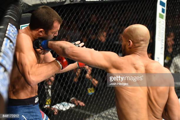 David Branch punches Luke Rockhold in their middleweight bout during the UFC Fight Night event inside the PPG Paints Arena on September 16 2017 in...