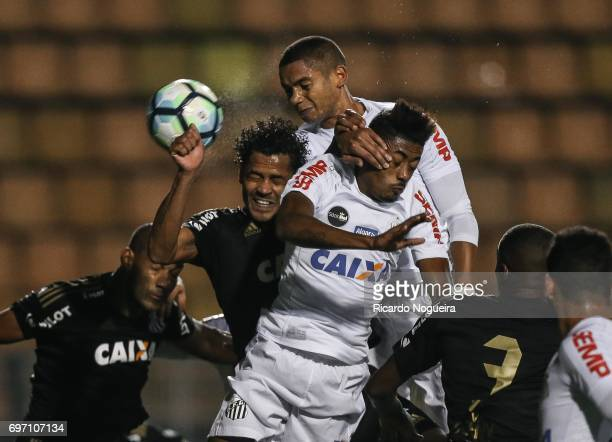 David Braz and Bruno Henrique of Santos battles for the ball with Elton of Ponte Preta during the match between Santos and Ponte Preta as a part of...