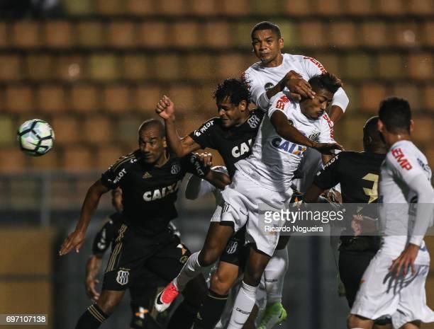 David Braz and Bruno Henrique of Santos battles for the ball with Elton of Ponte Preta during the match between Santos and Ponte Preta as a part of...
