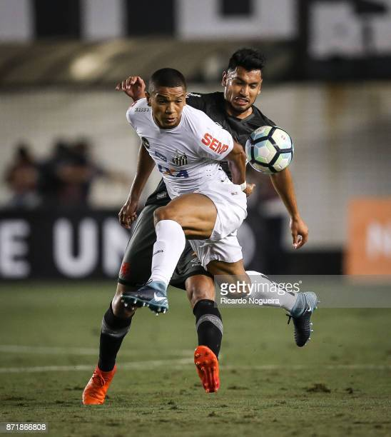 David Braz of Santos battles for the ball with Andres Rios of Vasco during the match between Santos and Vasco da Gama as a part of Campeonato...