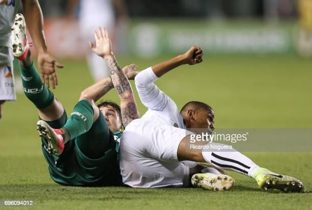 David Braz of Santos battles with Roger Guedes of Palmeiras during a match between Santos and Palmeiras as a part of Campeonato Brasileiro 2017 at...