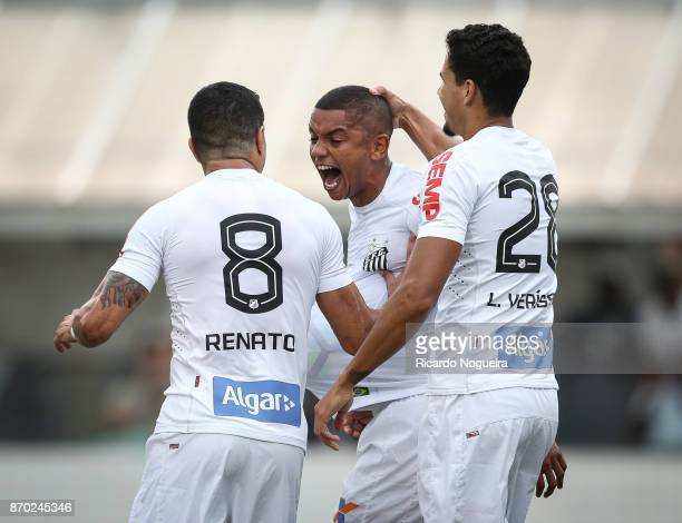 David Braz of Santos celebrates his goal with Renato and Lucas Verissimo during the match between Santos and Atletico Mineiro as a part of Campeonato...