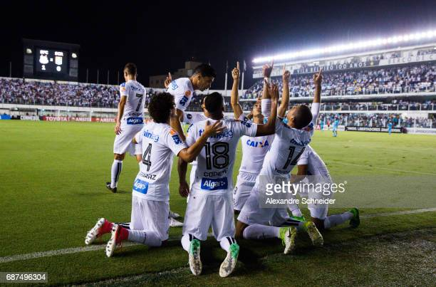 David Braz of Santos celebrates with his team mates after scoring their first goal during the match between Santos and Sporting Cristal for the Copa...