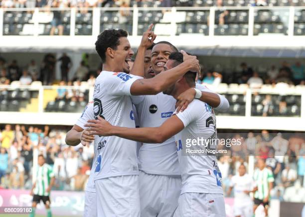 David Braz of Santos celebrates with teammates Lucas Verissimo and Thiago Maia after scoring Santos opening goal during a match between Santos and...