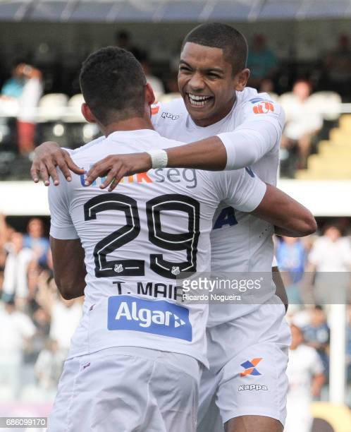 David Braz of Santos celebrates with Thiago Maia after scoring Santos opening goal during a match between Santos and Coritiba as a part of Campeonato...