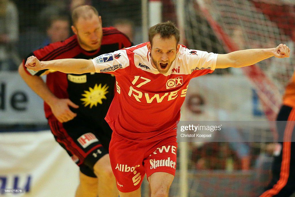 David Breuer of TUSEM Essen celebrates a goal during the DKB Handball Bundesliga match between TUSEM Essen and Tus N-Luebbecke at the Sportpark Am Hallo on March 31, 2013 in Essen, Germany.