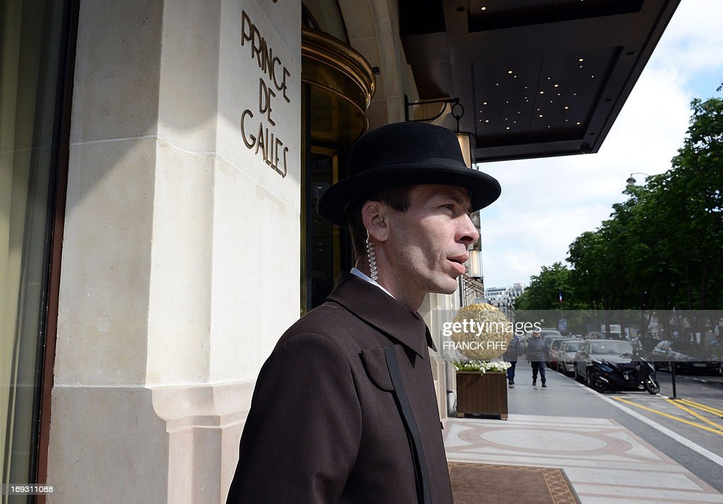 David Bricaud, a valet at the luxury hotel 'Prince de Galles' (Prince of Wales), is pictured on May 22, 2013, at the hotel in Paris. The Prince de Galles, on the Avenue George V in Paris reopened on May 16, 2013 under the 'Luxury Collection' brand after two years of renovation. The luxury hotel, with 159 rooms, a restaurant and bar, was built in 1928 and was closed since February 2011. The hotel received a fifth star on its reopening. AFP PHOTO / FRANCK FIFE
