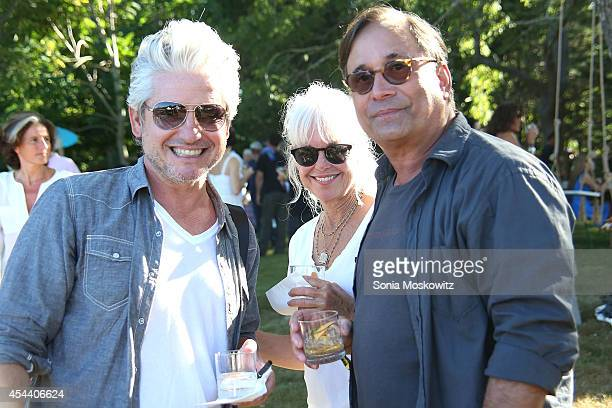 David Brock Nicole Young and Ross Bleckner attend the Perfect Earth Project Family Picnic and Concert on August 30 2014 in East Hampton New York
