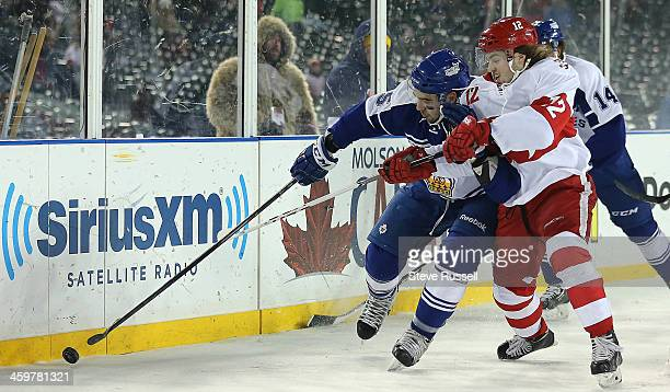 DETROIT MI DECEMBER 30 David Broll fights off Calle Jarnkrok as the Toronto Marlies play the Grand Rapid Griffins outside at Comerica Park in Detroit...