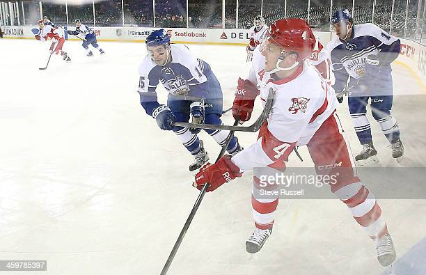 DETROIT MI DECEMBER 30 David Broll gets his stick up on Nathan Paetsch as the Toronto Marlies beat the Grand Rapid Griffins in a shootout in the...