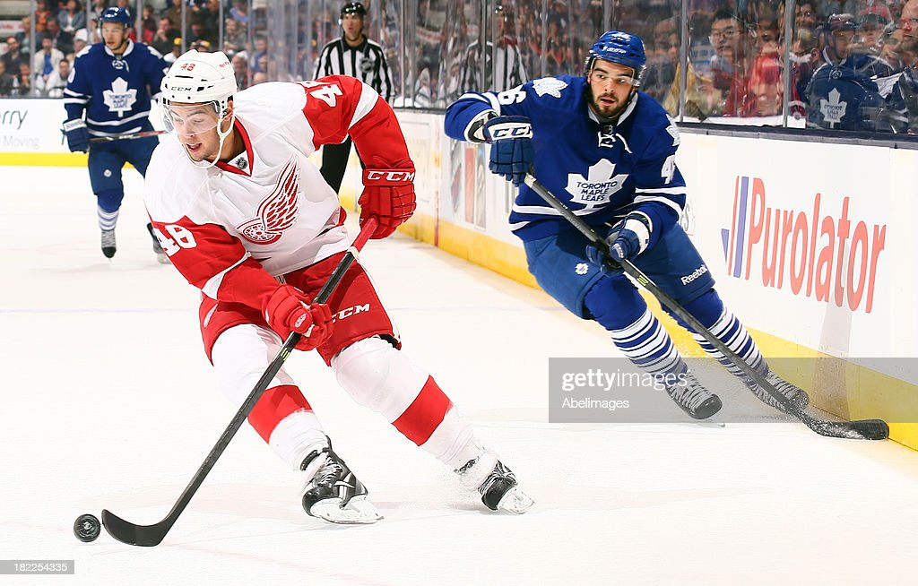 David Broll #46 of the Toronto Maple Leafs chases Ryan Sproul #48 of the Detroit Red Wings during NHL Preseason action at the Air Canada Centre September 28, 2013 in Toronto, Ontario, Canada.