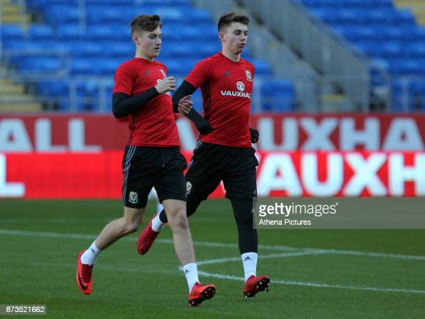 David Brooks and Ben Woodburn warm up during the Wales Press Conference and Training Session at The Cardiff City Stadium on November 13 2017 in...
