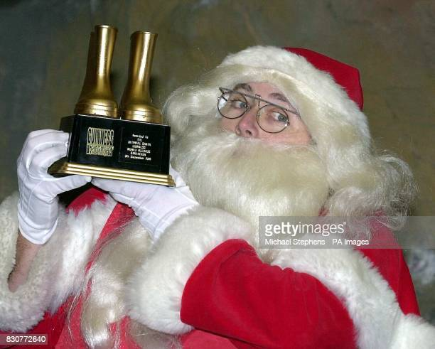 David Broughton from Wrexham Wales who works in a grotto at Selfridges in London's Oxford Street with his Golden Boots award after winning the...