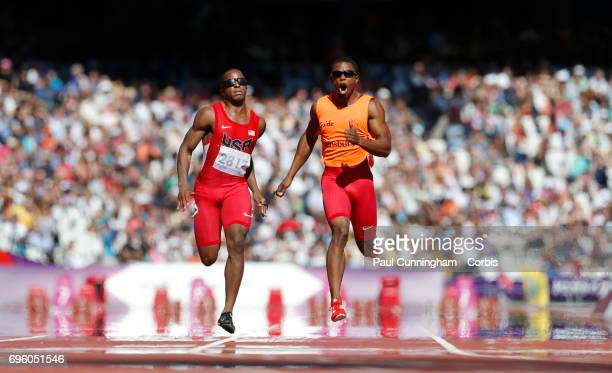 David Brown with guide Rolland Slade running in the Men's 100m T11 Round 1 during day 9 of the London 2012 Paralympic Games at the Olympic Stadium on...