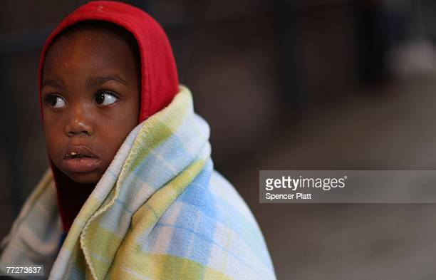 David Bruce waits with his family outside of the emergency overnight shelter intake center October 11 2007 in the Bronx borough of New York City...