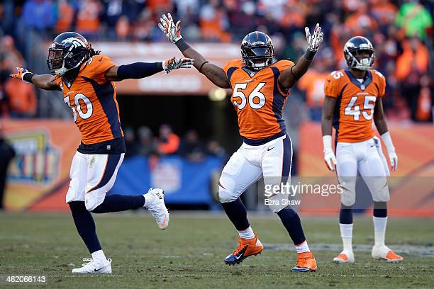 David Bruton and Nate Irving of the Denver Broncos celebrates after a missed field goal by the San Diego Chargers during the AFC Divisional Playoff...