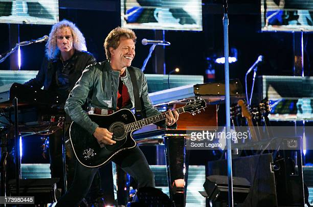 David Bryan and Jon Bon Jovi of the rock band Bon Jovi performs during their 'Because We Can Tour' at Ford Field on July 18 2013 in Detroit Michigan