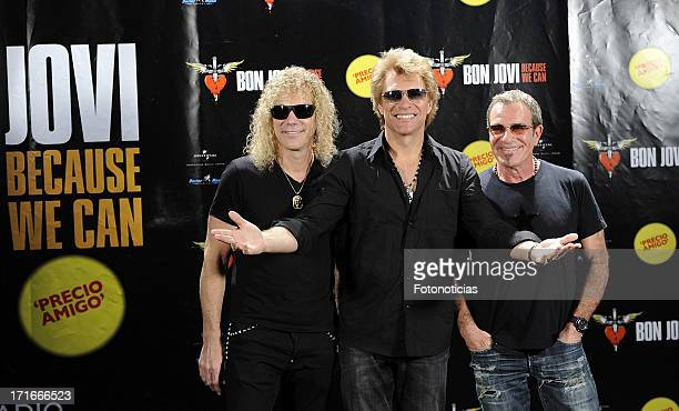 David Bryan Jon Bon Jovi and Tico Torres of Bon Jovi attend a photocall ahead of their concert at the Estadio Vicente Calderon on June 27 2013 in...