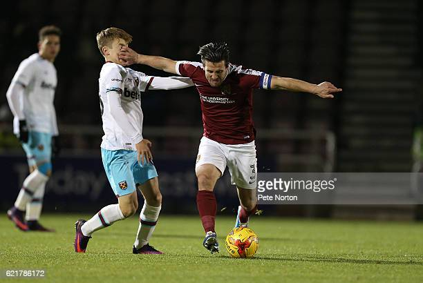 David Buchanan of Northampton Town holds off the challenge from Dan Kemp of West Ham United U21 during the EFL Checkatrade Trophy match between...