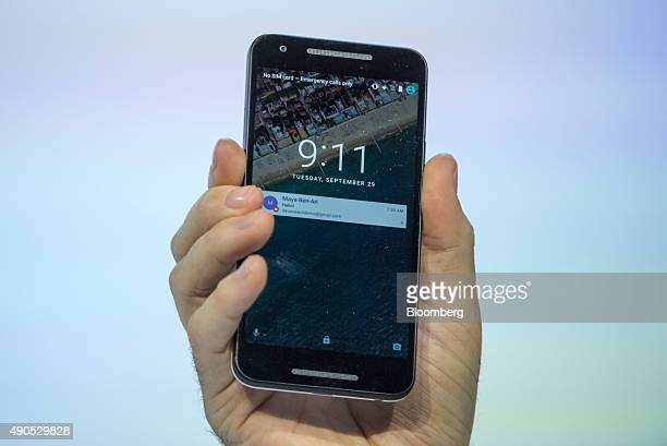 David Burke director of Android engineering for Google Inc holds a Nexus 6P smartphone while speaking during an event in San Francisco California US...
