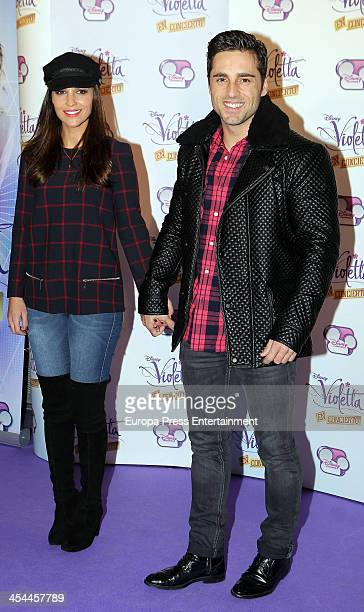 David Bustamante and Paula Echevarria attend the concert of Argentine singer Martina Stoessel 'Violetta' on Disney Channel on December 8 2013 in...
