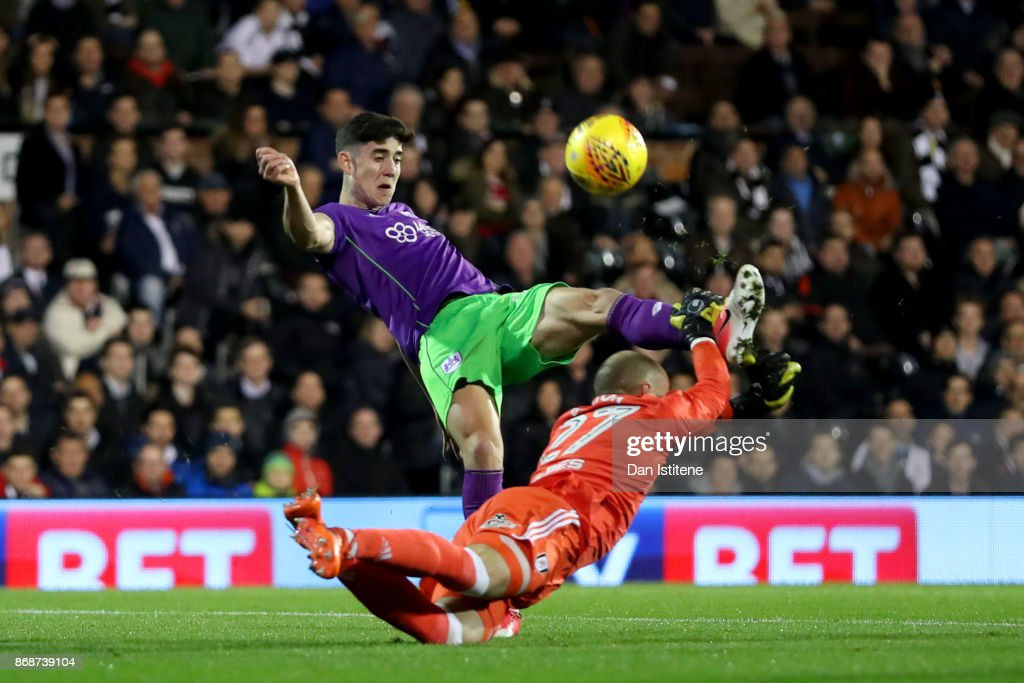 David Button of Fulham dives at the feet of Callum O'Dowda of Bristol City to block his shot during the Sky Bet Championship match between Fulham and Bristol City at Craven Cottage on October 31, 2017 in London, England.