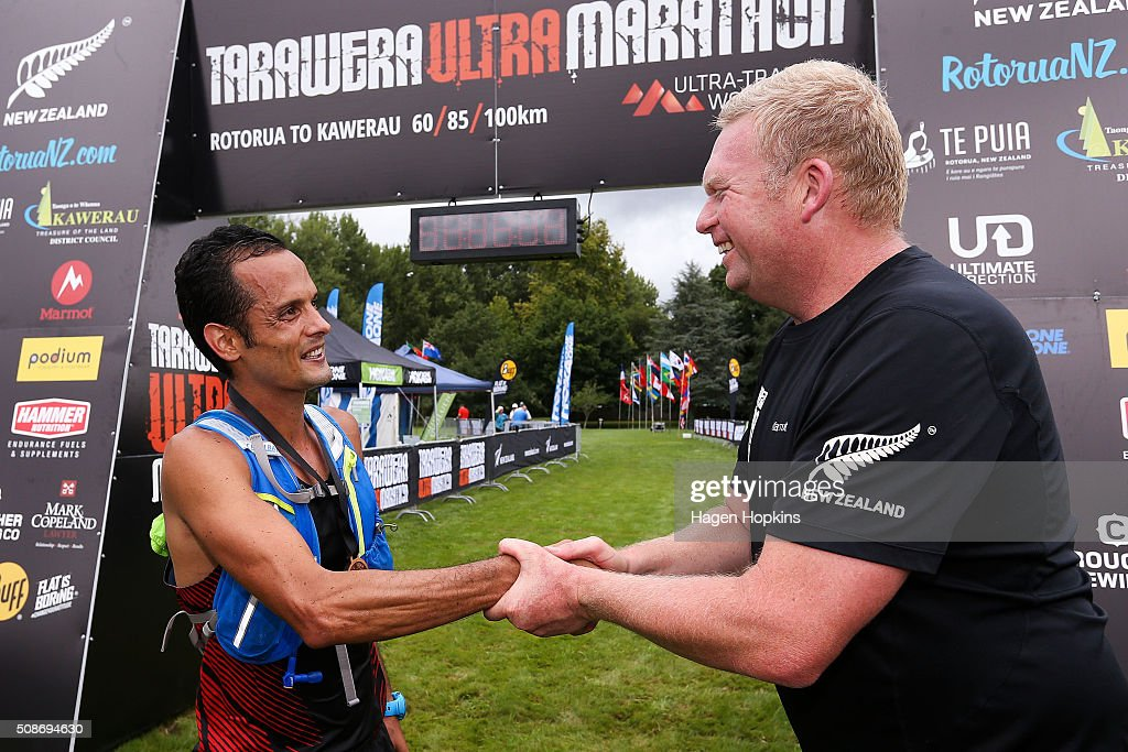 David Byrne of Australia shakes hands with event organiser Paul Charteris at the finish of the Tarawera Ultramarathon on February 6, 2016 in Rotorua, New Zealand.