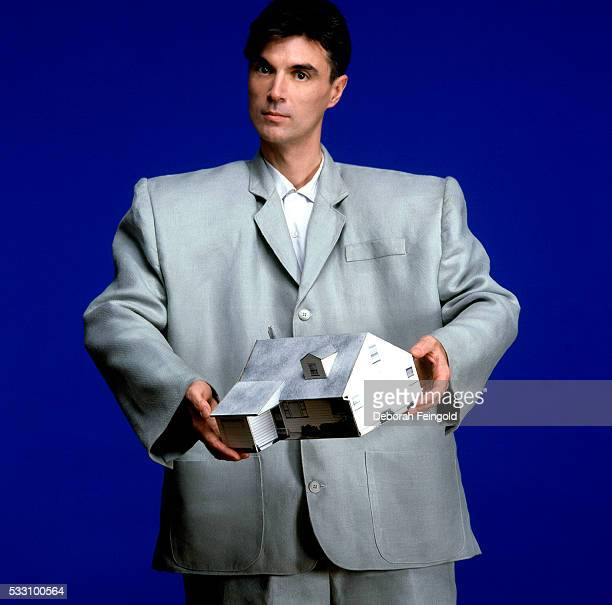 David Byrne poses in a big suit for a photo shoot