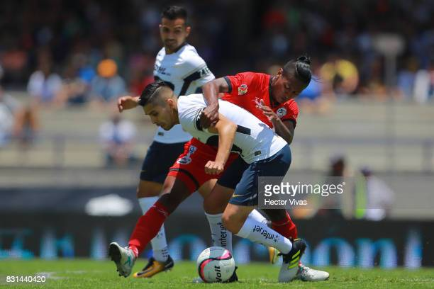 David Cabrera of Pumas struggles for the ball with Pedro Aquino of Lobos BUAP during the fourth round match between Pumas UNAM and Lobos BUAP as part...