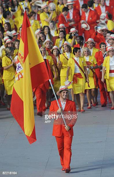 David Cal Spain's flag bearer parades in front of his delegation during the 2008 Beijing Olympic Games opening ceremony on August 8 2008 at the...