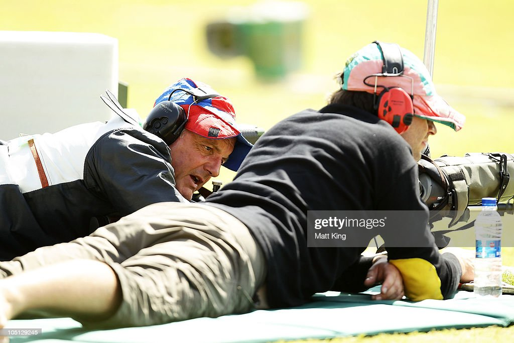 David Calvert (L) and Ross McQuillan compete in stage 2 of the 500 yards Pairs Full Bore Open at the CRPF Campus, Kadarpur during day seven of the Delhi 2010 Commonwealth Games on October 10, 2010 in Gurgaon, India.