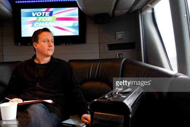 David Cameron leader of the Conservative party Britain's opposition party on board a bus while campaigning for the general election on April 10 2010...