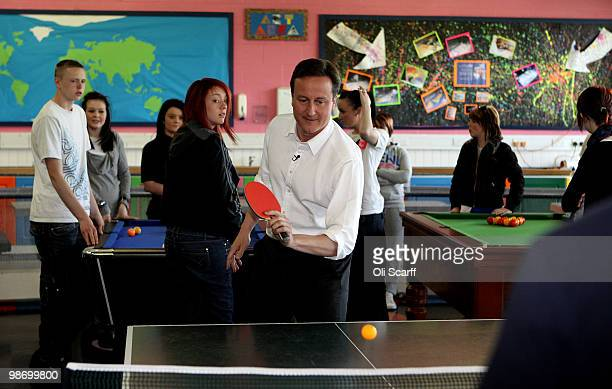 David Cameron the leader of the Conservative party plays table tennis in the 'Bolton Lads and Girls Club' on April 27 2010 in Bolton England Mr...