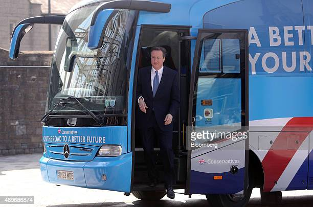 David Cameron UK prime minister and leader of the Conservative Party steps off of the party's campaign bus as he arrives to unveil the party's 2015...